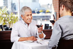 Man and senior drinking wine Stock Image