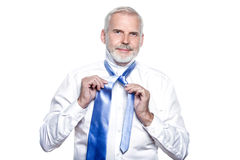 Man senior getting dressed tying windsor necktie Royalty Free Stock Photos