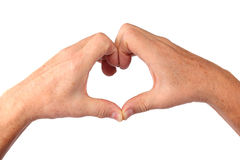 Man senior hands show heart gesture. Isolated Royalty Free Stock Image