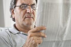 Man senior reading newspaper. Man senior reading  a newspaper Royalty Free Stock Photo