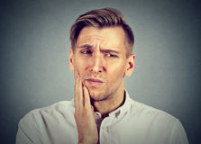 Man with sensitive toothache problem about to cry from pain Royalty Free Stock Images