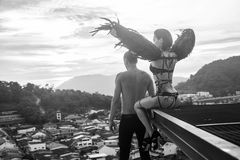 Man with sensual black angel woman on the rooftop Stock Photography