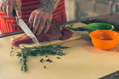 Man separating beef into pieces Stock Images