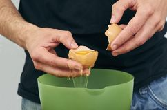 Man separating the yolk from the egg white. Bake bowl separate hand action baking kitchen cholesterol raw cuisine detail domestic food fresh ingredient cook stock photography