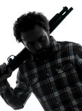 Man serial killer with shotgun silhouette portrait Stock Photo