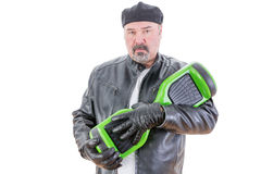 Man with serious expression with hoverboard Royalty Free Stock Photos