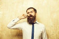 Man on serious face smoking cigar royalty free stock image