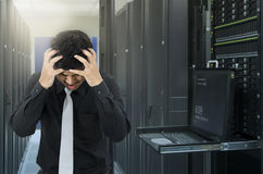 Man serious fail in data center with trouble of server Stock Photos
