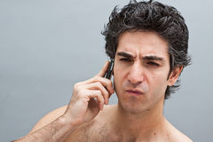 Man on a serious phone call Stock Photography