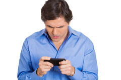 Man seriously texting someone Royalty Free Stock Photography