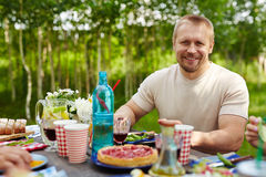Man by served table Stock Photos