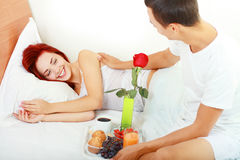 Man serves breakfast in bed Royalty Free Stock Photo