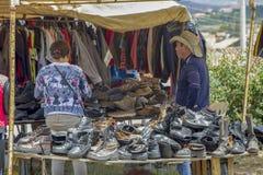 A man serves a woman customer royalty free stock photos