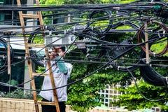 Man service on electrick line Stock Image