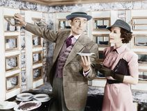 Free Man Serving A Dish To A Woman In A Automat Royalty Free Stock Image - 52026586