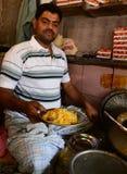 Man serving biryani Royalty Free Stock Image