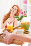 Girl on bed. Man serving breakfast for his wife in bed at home Royalty Free Stock Images