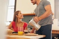 Man serving breakfast to his girlfriend Stock Image