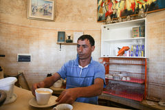 Man serving coffee at Dar Ayed Stock Images