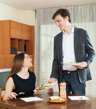 Man serving dinner to young woman Royalty Free Stock Images