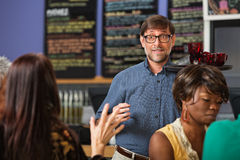 Man Serving Drinks Stock Images