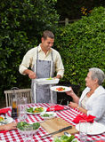 Man serving his family at the table stock photography