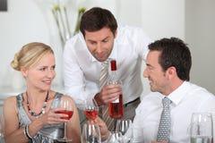 Man serving rose wine Stock Images