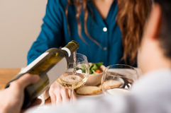 Man serving white wine Royalty Free Stock Images