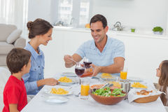 Man serving wife during the dinner Royalty Free Stock Photography