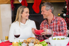 Man serving wife during the dinner Stock Photos