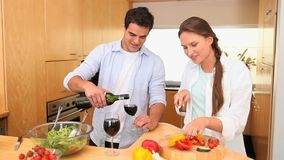 Man serving wine to his wife stock video footage