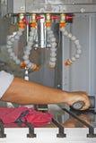 Man set up dial gauge for setting balance work   after cutting o. F CNC Stock Image