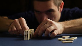 Man set up the domino with hand. Domino effect. 4K stock video footage