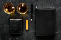 Man set. Whiskey with ice, cigar, wallet and notebook black bar background top view copyspace Royalty Free Stock Images
