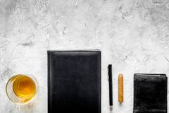 Man set. Whiskey with ice, cigar, wallet and notebook on stone bar background top view copyspace Royalty Free Stock Photography