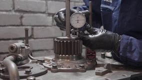A man sets a dial gauge. A man installs a dial gauge on the engine stock video footage