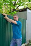 Man sets metal fence royalty free stock photos