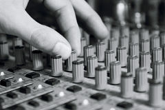 Man sets up the mixer to adjust the sound and recording Stock Photos
