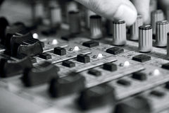 Man sets up the mixer to adjust the sound and recording Royalty Free Stock Photos