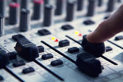 Man sets up the mixer to adjust the sound and recording Royalty Free Stock Photography