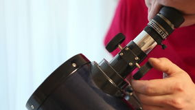 Man sets up a telescope stock video