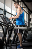 Man setting treadmill Royalty Free Stock Image