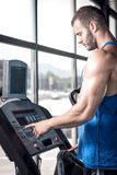Man setting treadmill Royalty Free Stock Photography