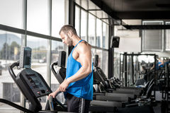 Man setting treadmill Stock Photo