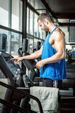 Man setting treadmill Stock Image