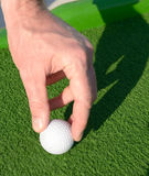 Man setting up a minigolf ball Stock Photography