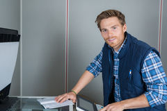 Man setting up photocopier. Man setting up a photocopier Royalty Free Stock Photography