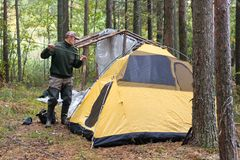 Man setting up a tent Royalty Free Stock Image