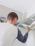 Man setting up ventilation Stock Photos