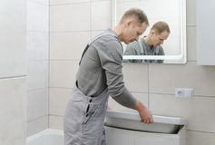 Installation the washbasin in the bathroom. royalty free stock photo